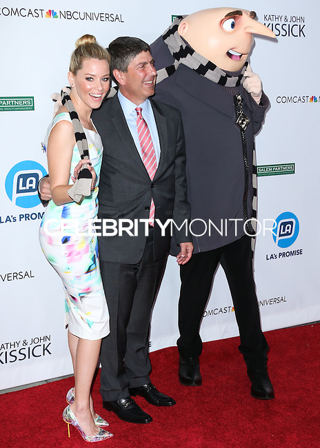 UNIVERSAL CITY, CA, USA - SEPTEMBER 30: Elizabeth Banks, Jeff Shell arrive at LA's Promise Gala 2014 held at the Globe Theatre at Universal Studios on September 30, 2014 in Universal City, California, United States. (Photo by Xavier Collin/Celebrity Monitor)