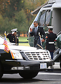 United States President Barack Obama salutes the Marine Guard as he arrives at Walter Reed National Military Medical Center to meet with wounded warriors, Bethesda, Maryland, November 5, 2013.<br /> Credit: Martin Simon / Pool via CNP