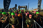 OCEANSIDE, CA - APRIL 7:  Age Group Triathletes prepare to enter the swim during the IRONMAN 70.3 Oceanside Triathlon on April 7, 2018 in Oceanside, California. (Photo by Donald Miralle for IRONMAN)