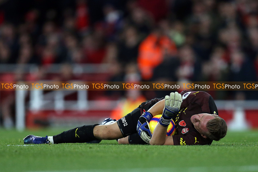 Bernd Leno of Arsenal lies injured after colliding with Helder Costa of Wolves during Arsenal vs Wolverhampton Wanderers, Premier League Football at the Emirates Stadium on 11th November 2018