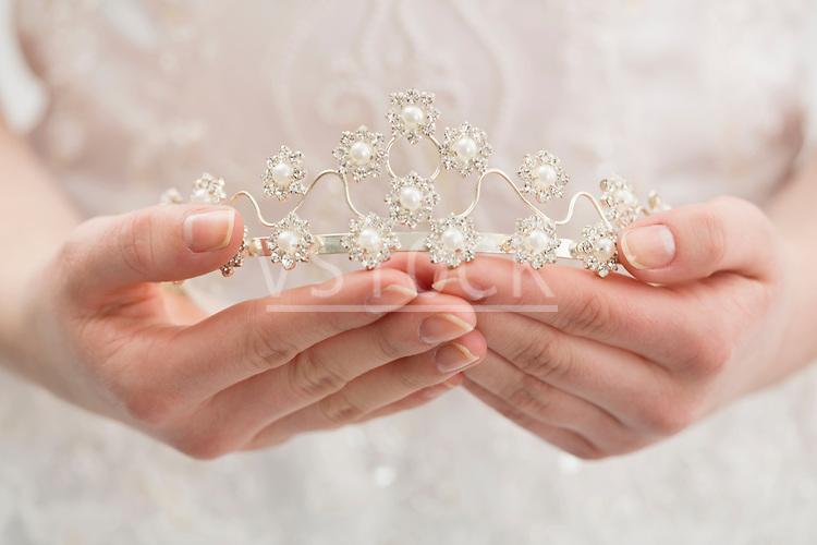 Bride holding diadem