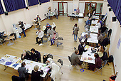 Residents talk with citizens advice bureau staff and jobs, benefits and banking advisors at an open day at the Beethoven Centre, Queens Park, London (24/10/03).