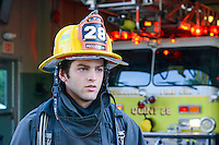 J.T Boyle stands in front of an engine at Eddington Fire Company Wednesday August 5, 2015 in Bensalem, Pennsylvania. (Photo by William Thomas Cain)