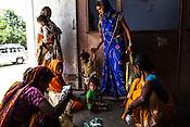 25 year old Dayawati (sitting, 2nd from left) waits to meet the Health post incharge at the local health centre in Hanuman Nagar in Saptari, Nepal.
