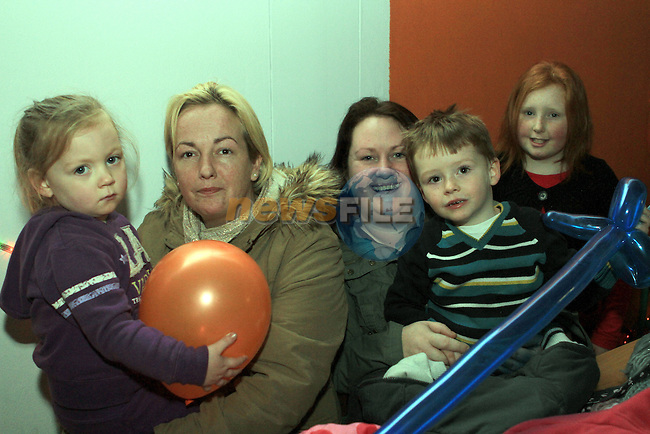 Leah Flood Coyle and Mary Boylan with Bernie, Thomas and Elisha Thornton at the Christmas Party in the Boxing Club...(Photo credit should read Jenny Matthews www.newsfile.ie)....This Picture has been sent you under the conditions enclosed by:.Newsfile Ltd..The Studio,.Millmount Abbey,.Drogheda,.Co Meath..Ireland..Tel: +353(0)41-9871240.Fax: +353(0)41-9871260.GSM: +353(0)86-2500958.email: pictures@newsfile.ie.www.newsfile.ie.