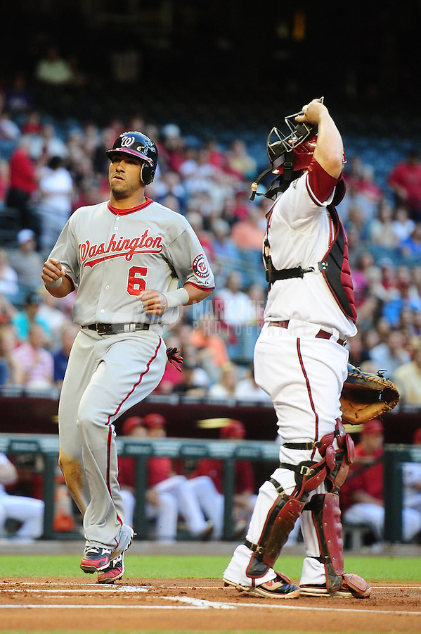 Jun. 2, 2011; Phoenix, AZ, USA; Washington Nationals shortstop Ian Desmond (6) crosses the plate to score in the first inning against the Arizona Diamondbacks at Chase Field. Mandatory Credit: Mark J. Rebilas-