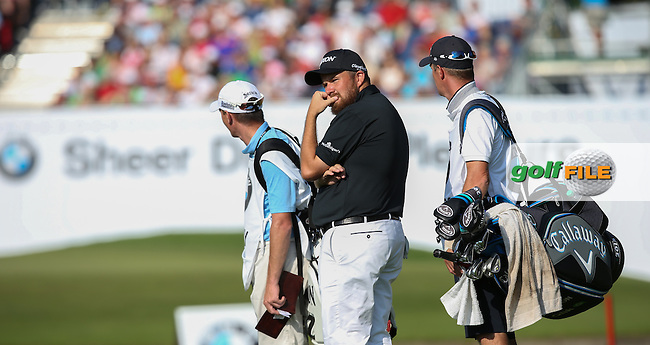 Shane Lowry (IRL) hanging about waiting for Martin Kaymer (GER) to sort out his troubles on the 18th fairway during Round Two of the 2015 BMW International Open at Golfclub Munchen Eichenried, Eichenried, Munich, Germany. 26/06/2015. Picture David Lloyd | www.golffile.ie