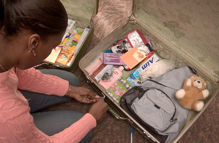 """Martin Luther King Jr. Day:..Khalilah Catchings fills  """"Love Luggage"""" to give to foster Children at Baker Center."""