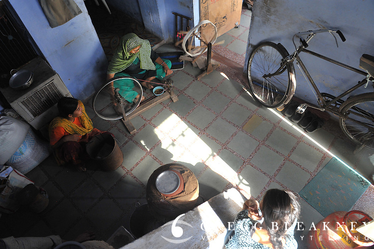 The old wheel of a weavers bicycle finds a new life in the workshop. Bundi, India.