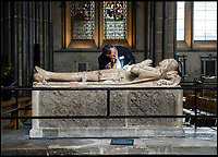 BNPS.co.uk (01202 558833)<br /> Pic: PhilYeomans/BNPS<br /> <br /> The alabaster tomb of leading Tudor knight Lord John Cheney has suffered much at the hands of graffiti artists - mainly it is thought during the Civil War when Puritan troops defaced it.<br /> <br /> Graffiti guide Steve Dunn hunts out some of the less profound iconography in the ancient cathedral.<br /> <br /> Salisbury Cathedral has taken the unusual step of launching 'Grafitti Tours' of it's 800 year old building, as part of a three year project to document the thousands of examples of centuries-old 'graffiti' which adorn the walls of the 13th century cathedral.<br /> <br /> The inside of the Cathedral in Wiltshire is covered in markings etched into its fabric by fervent, desperate or just bored visitors ranging from simple inscriptions to more intricate designs used to ward off evil spirits.  <br /> <br /> Cathedral guide Steve Dunn intends to record all the marks or 'graffiti' which in some cases date back from when the cathedral was completed in 1258.<br /> <br /> Helped by about 60 volunteers, he is collating images of the graffiti and researching the story behind them.