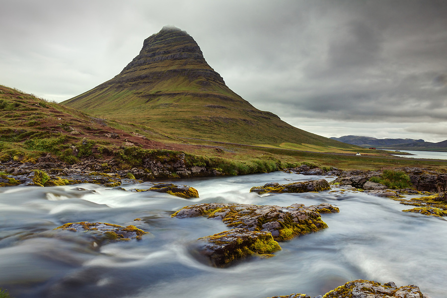The Kirkjufellsa River flows below Kirkjufell (Church Mountain), Grundarfjordur, Snaefellsnes peninsula, West Iceland, Iceland