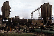 August 1981. Newcastle area, England. Outside Newcastle there is no one in the street, the traffic is minimal and the area has become a slum of abandoned factories.