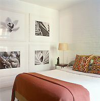 In the master bedroom four stunnning black-and-white photographs by Issa-Khan are displayed on white-painted brick walls