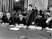 Paris, France - January 23, 1973 -- Assistant to the President (Nixon) for National Security Affairs Henry A. Kissinger, center, initials the Vietnam Peace Agreement in the International Conference Center in Paris France on Tuesday, January 23, 1973.<br /> Credit: White House via CNP