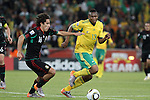 11 JUN 2010: Efrain Juarez (MEX) (16) and Kagisho Dikgacoi (RSA) (13). The South Africa National Team tied the Mexico National Team 1-1 at Soccer City Stadium in Johannesburg, South Africa in the opening match of the 2010 FIFA World Cup.