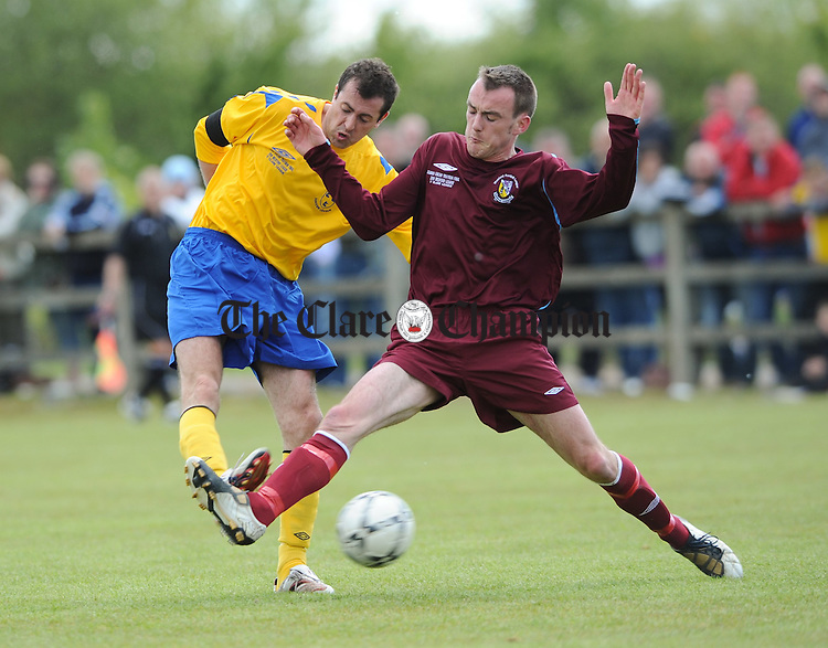 Con Collins of The Clare and District League in action against Sean Culleton of The Wexford League during their Oscar Traynor Final at Doora, Ennis. Photograph by John Kelly