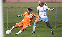 Sky Blue midfielder Julianne Sitch crosses the ball in front of Red Stars defender Frida Ostberg Sky Blue FC defeated the Chicago Red Stars 1-0 on Sunday, July 19, 2009.