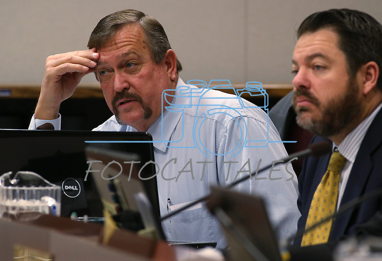 Nevada Assemblyman Cresent Hardy, R-Mesquite, left, and Sen. Michael Roberson, R-Las Vegas, work in committee at the Legislative Building, in Carson City, Nev., on Friday, April 26, 2013. .Photo by Cathleen Allison