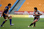 Koiatu Koiatu changes direction as Pelu Pavihi prepares to make a tackle during the Air NZ Cup game between Counties Manukau & Otago played at Mt Smart Stadium,Auckland on the 29th of July 2006. Otago won 23 - 19.