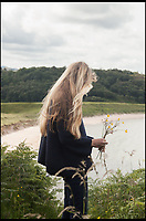 BNPS.co.uk (01202 558833)<br /> Pic: WildGuideScotland/BNPS<br /> <br /> Collecting wildflowers near remote Gaineamh Mhor beach.<br /> <br /> Scotland's stunning unspoiled scenery is being shown in a whole new light in a book that reveals the hidden gems off the beaten track north of the border.<br /> <br /> Three young photographers travelled the width and breadth of Scotland and snapped 750 picturesque places which include shimmering lochs, ancient forests, lost ruins, hidden beaches, secret islands, dramatic cliffs, tiny glens and mysterious grottoes. <br /> <br /> Friends Kimberley Grant, David Cooper and Richard Gaston, all in their late 20s, have spent the past two years exploring lesser known idyllic spots which they are keen to bring to a wider audience.