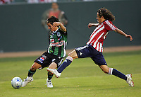 Chivas USA defender Francisco Mendoza (6) and Santos Laguna defender Jorge Estrada (4) chase down a ball. Chivas USA defeated the Santos of Laguna 1-0 during the 1st round of the 2008 SuperLiga at Home Depot Center stadium, in Carson, California on Wednesday, July 16, 2008.