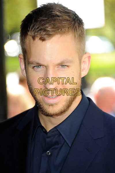 Calvin Harris.58th annual Ivor Novello songwriting and composing awards, Grosvenor House, London, England, UK, 16th May 2013..portrait headshot blue beard facial hair navy shirt .CAP/CJ.©Chris Joseph/Capital Pictures.