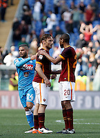 Calcio, Serie A: Roma vs Napoli. Roma, stadio Olimpico, 25 aprile 2016.<br /> Roma's Francesco Totti, center, is hugged by his teammate Seydou Keita as Napoli's Lorenzo Insigne, left, reacts at the end of the Italian Serie A football match between Roma and Napoli at Rome's Olympic stadium, 25 April 2016. Roma won 1-0.<br /> UPDATE IMAGES PRESS/Isabella Bonotto