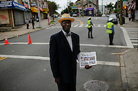A man offers the Final call newspaper while People march against police brutality in Staten Island. 08.23.2014. Eduardo Munoz Alvarez/VIEWpress