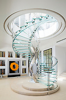 In the spacious entrance hall, the delicate spiral staircase designed by Eva Jiricna rises up into a domed skylight.