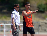 Apr 11, 2015; Los Angeles, CA, USA; Occidental College Tigers high jump coach David Foley (left) and Tyler Walton during the high jump in a SCIAC multi dual meet at Occidental College. Photo by Kirby Lee