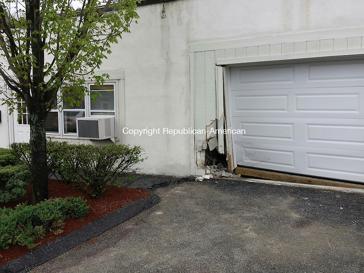 TORRINGTON, CT- 15 May 2014- 051514BJ02-- A motor vehicle crash on East Main Street Thursday morning damaged the garage and wall in the back entrance of CT Family Home & Hearth. The crash remains under investigation by Torrington police.