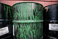 Flushing, NY - 16 August 2005 - A barril of US Open Green paint used on the court surface stands outside the National Tennis Center - home of the US Open - in Flushing, Queens, NY, USA, 16 August 2005.