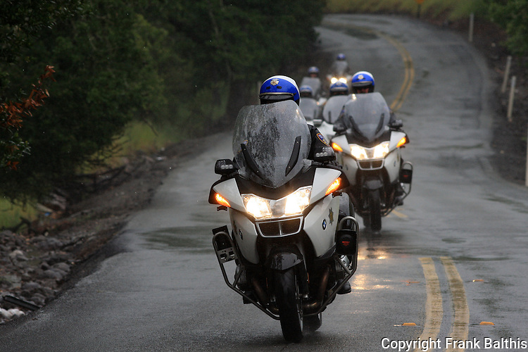 Police motorcycles clearing race course for Tour De California on Bennett Valley Rd.