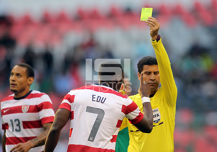 MEXICO CITY, MEXICO - AUGUST 15, 2012:  Maurice Edu (7) of the USA MNT protests a yellow card from referee Walter Quesada during an international friendly match at Azteca Stadium, in Mexico City, Mexico on August 15. USA won 1-0.