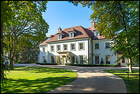 BNPS.co.uk (01202 558833)<br /> Pic: Savills/BNPS<br /> <br /> Three-mendous!<br /> <br /> The Colonial style main house.<br /> <br /> Stunning seaside estate overlooking Sandbanks that wouldn't look out of place in the Hollywood Hills - and you get three properties for your &pound;9 million price tag.<br /> <br /> You get three luxury homes for the price of one with this spectacular private coastal estate - but they will still need deep pockets as the trio of properties are on the market for &pound;8.995m.<br /> <br /> The Mulberry House Estate is in the leafy Canford Cliffs area of Poole, Dorset, and has a grand five-bedroom mansion, a second detached five-bedroom house and a two-bedroom gate house.<br /> <br /> Locals describe the Canford Cliffs area as the 'Hollywood Hills' of the coastal property hotspot, more refined and less showy than the more 'Malibu style' Sandbanks peninsula that it overlooks.<br /> <br /> Offering beautiful views but with privacy and seclusion, and without the tourist crowds that the Sandbanks millionaire's enclave attracts.<br /> <br /> Estate agent Savills say the sale is a &quot;unique opportunity&quot; as the 2.2 acre Mulberry property is the only private estate in the area.