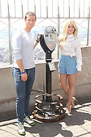 "NEW YORK, NY - JULY 11: Julianne Hough and Bear Grylls visit the Empire State Building in celebration of the season premiere of ""Runing Wild with Bear Grylls"" on July 11, 2016 in New York City. Credit: DC/Media Punch"