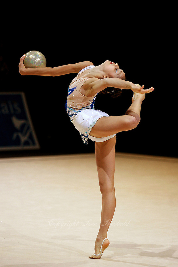 Anahi Sosa of Argentina holds balance with ball during exhibition before competition at 2006 Thiais Grand Prix in Paris, France on March 25, 2006.  (Photo by Tom Theobald)