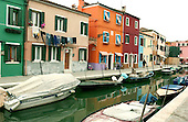 Burano, Italy - March 25, 2006 -- Scene of the colorful homes along the canals of Burano, Italy on March 25, 2006.  Burano is one of the most densely populated islands on the lagoon that includes Venice, Italy..Credit: Ron Sachs / CNP