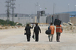 Palestinian Christians walk towards Erez crossing in the northern Gaza Strip on May 11, 2009 after Israel granted 95 permits for Christians from the isolated and impoverished territory to travel to the West Bank town of Bethlehem where the visiting Pope Benedict XVI will give a mass and visit a Palestinian refugee camp. Around 2,500 Christians live among Gaza's 1.4 million-strong Muslim population, including around 200 Catholics. APAimages/Ashraf Amra