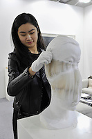 HONG KONG - MARCH 12:  An exhibitor demonstrates the possibilities of sculpture 'Bust of a Boy'' by Li Hongbo in art fair Art Central on its first day on March 13, 2015 in Hong Kong, Hong Kong.  (Photo by Lucas Schifres/Getty Images)