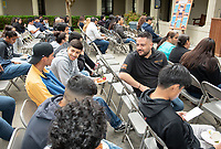"""Horacio Aceves, Academic Coordinator for Upward Bound.<br /> Upward Bound hosts their annual """"End of the Year"""" celebration with participants and their families on May 12, 2018 in the courtyard of Booth Hall. Jimmy Gomez, U.S. Representative for California's 34th congressional district, was the featured speaker at the event.<br /> Upward Bound was established at Occidental College in 1966 and has since served over 2000 first generation, low income students in the Los Angeles region.<br /> (Photo by Marc Campos, Occidental College Photographer)"""