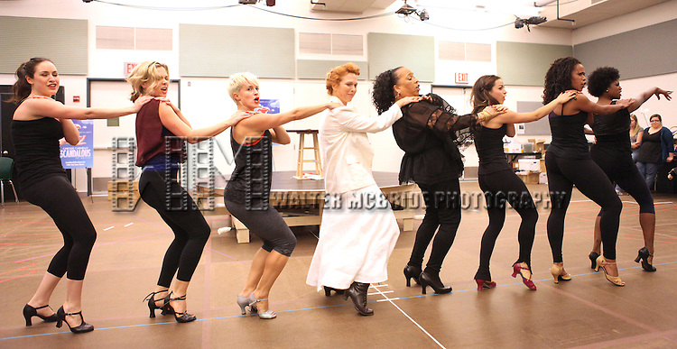 Actress Carolee Carmello and actress Roz Ryan with ensemble cast performing at the rehearsal presentation for 'Scandalous The Musical' at the New 42nd Street Studios on Monday, Sept. 24, 2012 in New York.