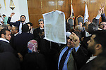 Egyptians hold banners and shout slogan during a protest in front of the State Council courthouse after a ruling against the Egypt-Saudi border demarcation agreement, Cairo, Egypt, 26 June 2016. The Administrative Court had ruled last Tuesday that the Saudi-Egyptian agreement was void, putting Red Sea islands Tiran and Sanafir under Egyptian sovereignty. According to Egyptian law, the ruling is to be respected until a decision on the appeal is issued. Photo by Amr Sayed