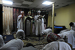 Eritrean clerics and worshippers, asylum-seekers, conduct a prayer at their makeshift church in southern Tel Aviv, Israel.