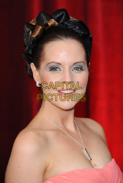 STEPHANIE WARING.The British Soap Awards 2010, London Television Centre, London, England..8th May 2010.arrivals headshot portrait hair up pink strapless blue eyeshadow make-up silver necklace  .CAP/BEL.©Tom Belcher/Capital Pictures.