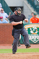 Home plate umpire Kevin Morgan calls a batter out on strikes to end the game between the Augusta GreenJackets and the Greensboro Grasshoppers at NewBridge Bank Park on August 11, 2013 in Greensboro, North Carolina.  The GreenJackets defeated the Grasshoppers 6-5 in game one of a double-header.  (Brian Westerholt/Four Seam Images)