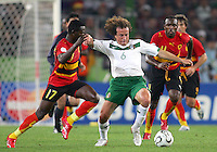 Gerardo Torrado (6) of Mexico clears the ball from two Angolan attackers. Mexico and Angola played to a 0-0 tie in their FIFA World Cup Group D match at FIFA World Cup Stadium, Hanover, Germany, June 16, 2006.