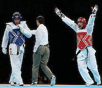 11.08.2012. London, England. Sebastian Eduardo Crismanich of Argentina Red Celebrates After Winning Over Nicolas Garcia Hemme of Spain during The Gold Medal Match of Mens Taekwondo 80kg Event London 2012 Olympic Games  Crismanich of Argentina Won The Match and claimed The Gold Medal