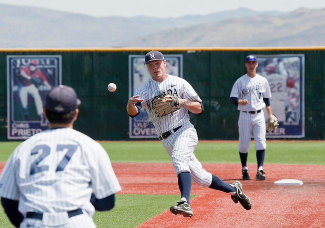 April 28, 2012:   Nevada Wolf Pack's Joe Kohan makes the off balance throw to first against the Fresno State Bulldogs during their NCAA baseball game played at Peccole Park on Saturday afternoon in Reno, Nevada.