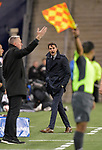 Monterrey head coach Diego Alsonso (center) yells at an official as Sporting KC head coach Peter Vermes (left) gestures during their CONCACAF Champions League semifinal soccer game on April 11, 2019 at Children's Mercy Park in Kansas City, Kansas.  Photo by TIM VIZER/AFP